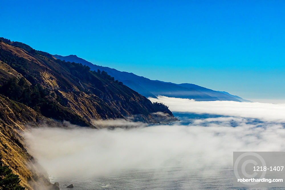 Fog gliding across the sea and up onto Highway 1, California, United States of America, North America