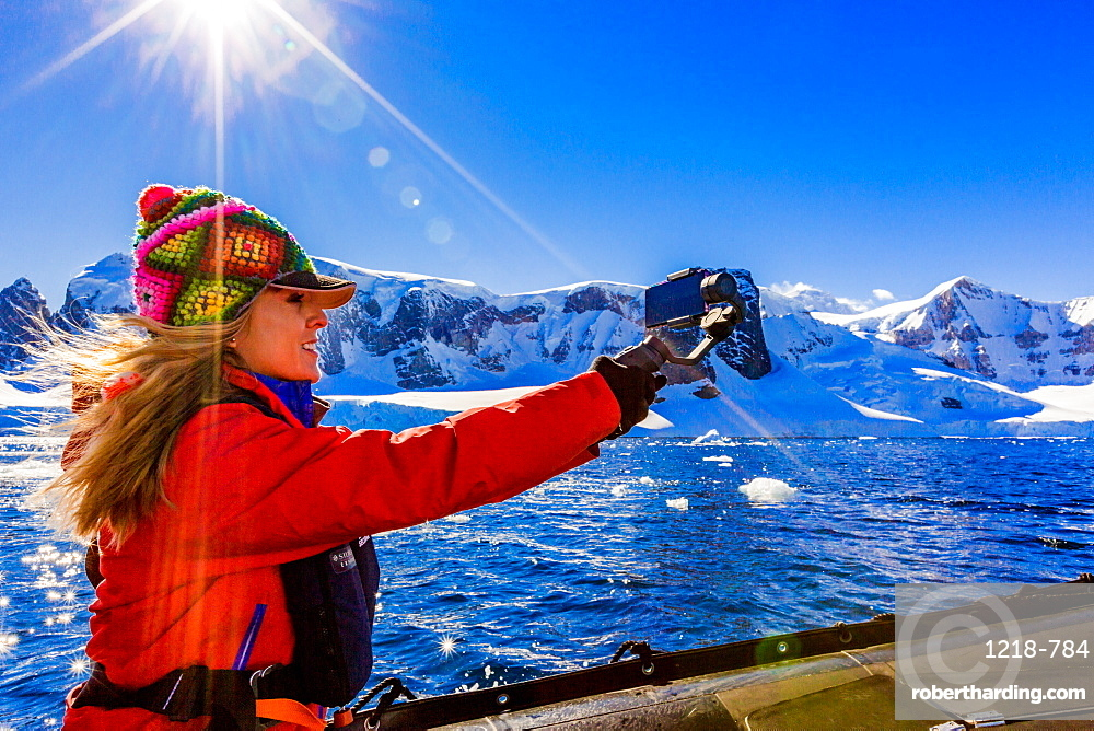 Documenting the scenic view of the glacial ice and floating icebergs in Antarctica, Polar Regions
