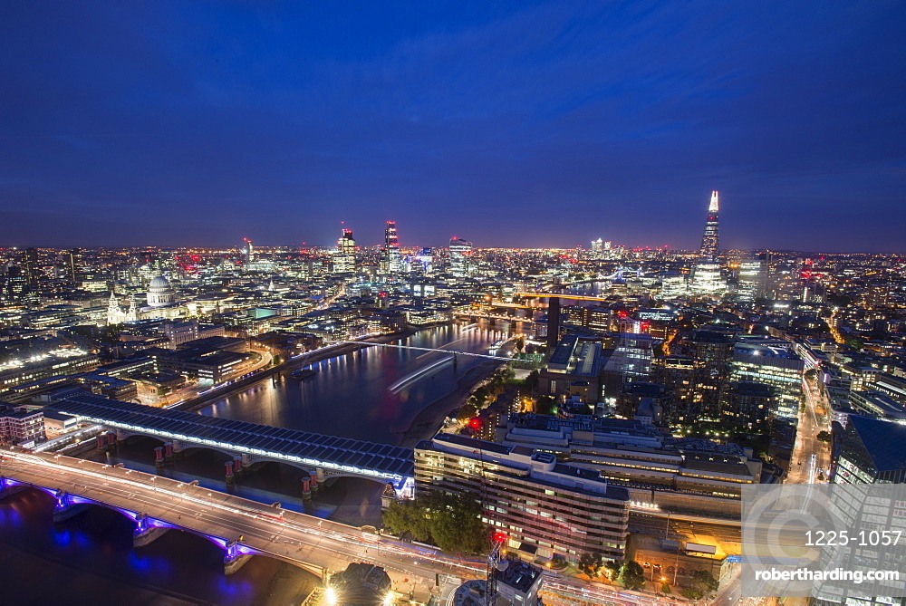 A night-time view of London and the River Thames from the top of Southbank Tower including The Shard, St. Paul's Cathedral and Tate Modern, London, England, United Kingdom, Europe