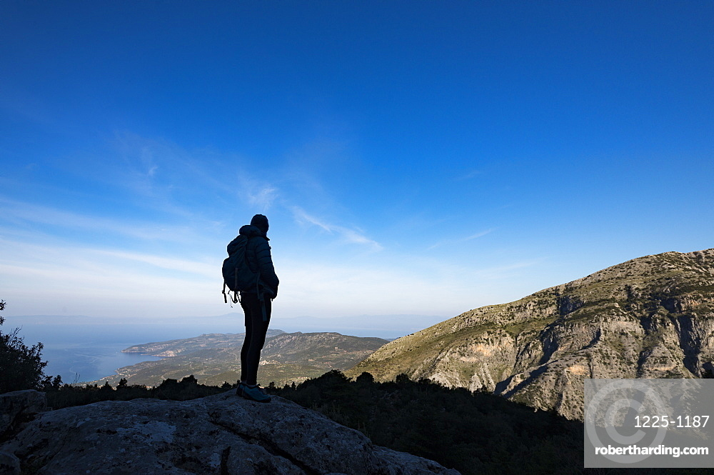 A woman hiking in the Taygetos Mountains on the Mani Peninsula in the Peloponnese, Greece, Europe