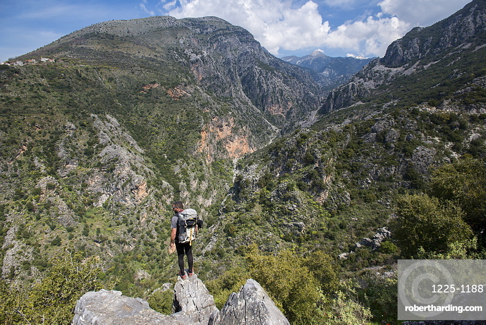 A man hiking in the Taygetos Mountains on the Mani Peninsula, Peloponnese, Greece, Europe