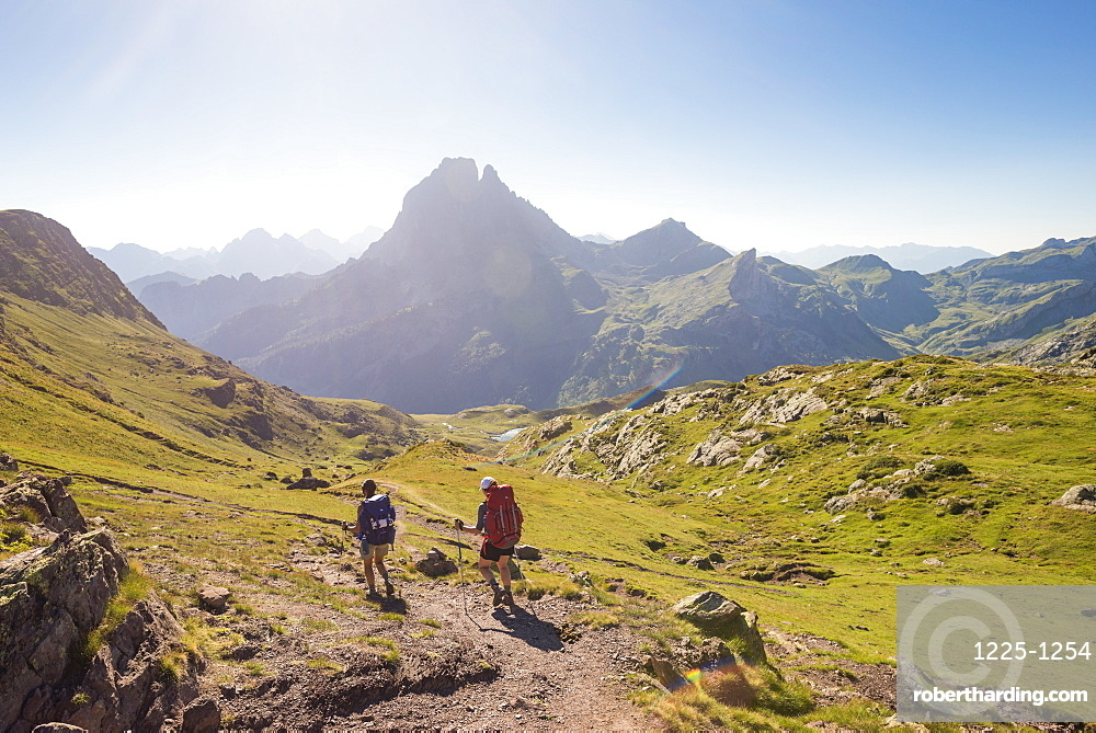 Walkers descend from the top of Col d'Ayous on the GR10 trekking route in the French Pyrenees, Pyrenees Atlantiques, France, Europe