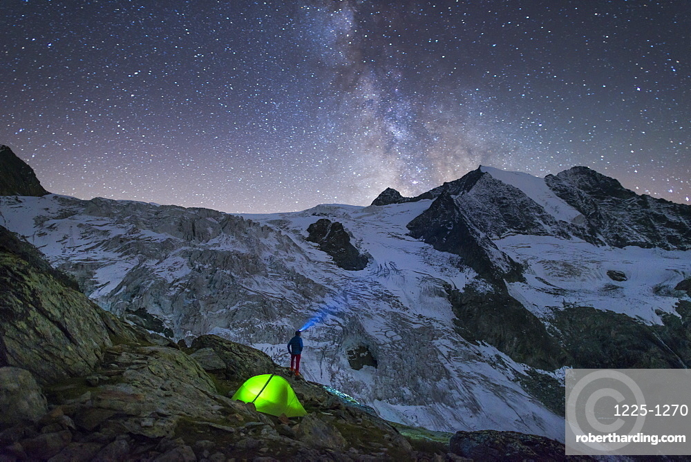 Starry sky and tent along The Walkers Haute Route from Chamonix to Zermatt, Swiss Alps, Switzerland, Europe