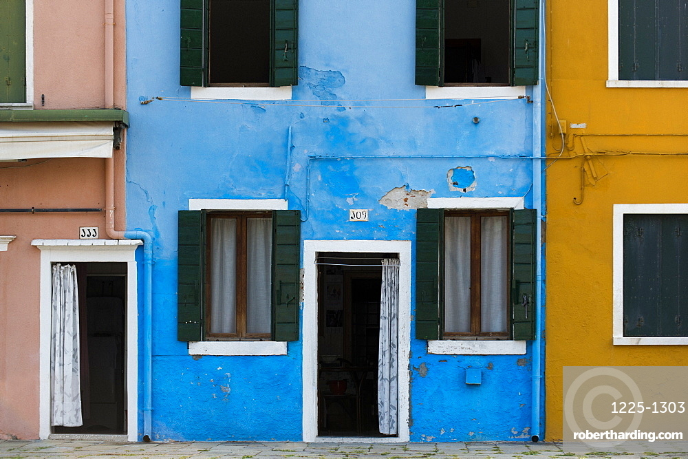 Exterior facades, doors and windows of colourful buildings and walls on the island of Burano, Venice, Veneto, Italy, Europe