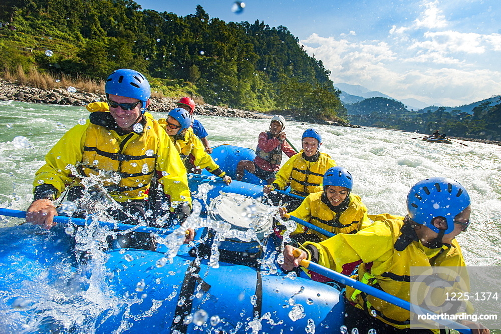 Rafters get splashed as they go through some big rapids on the Trisuli River, Nepal, Asia