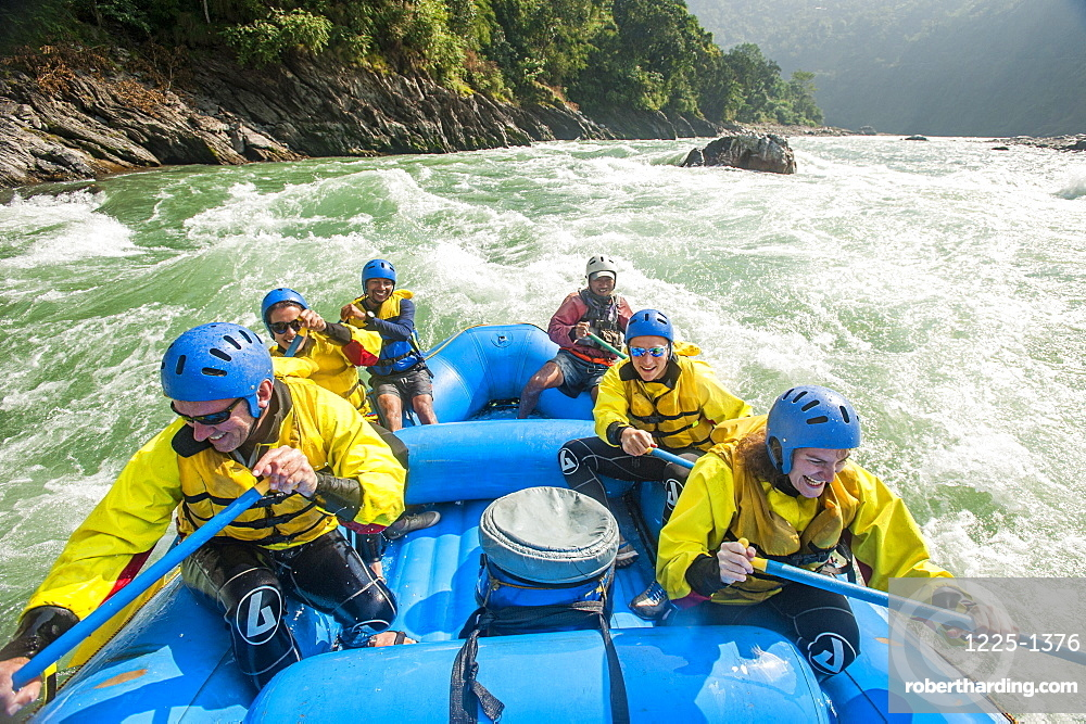 Rafters go through some rapids on the Trisuli River, Nepal, Asia