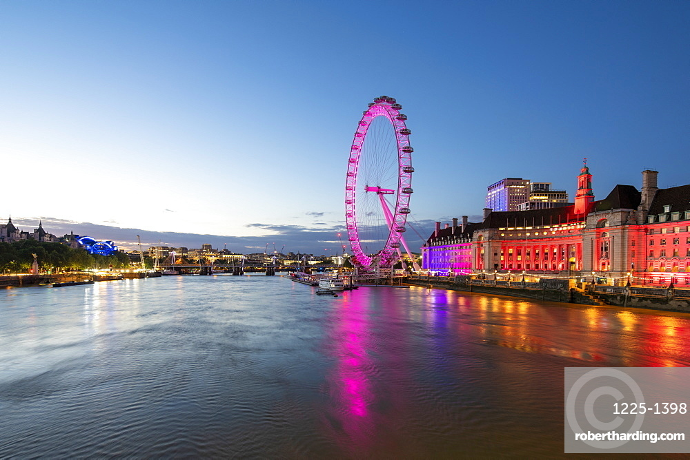 The London Eye lit up pink during blue hour, and River Thames, London, England, United Kingdom, Europe