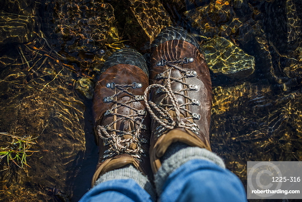 Boots in a stream, Cumbria, England, United Kingdom, Europe