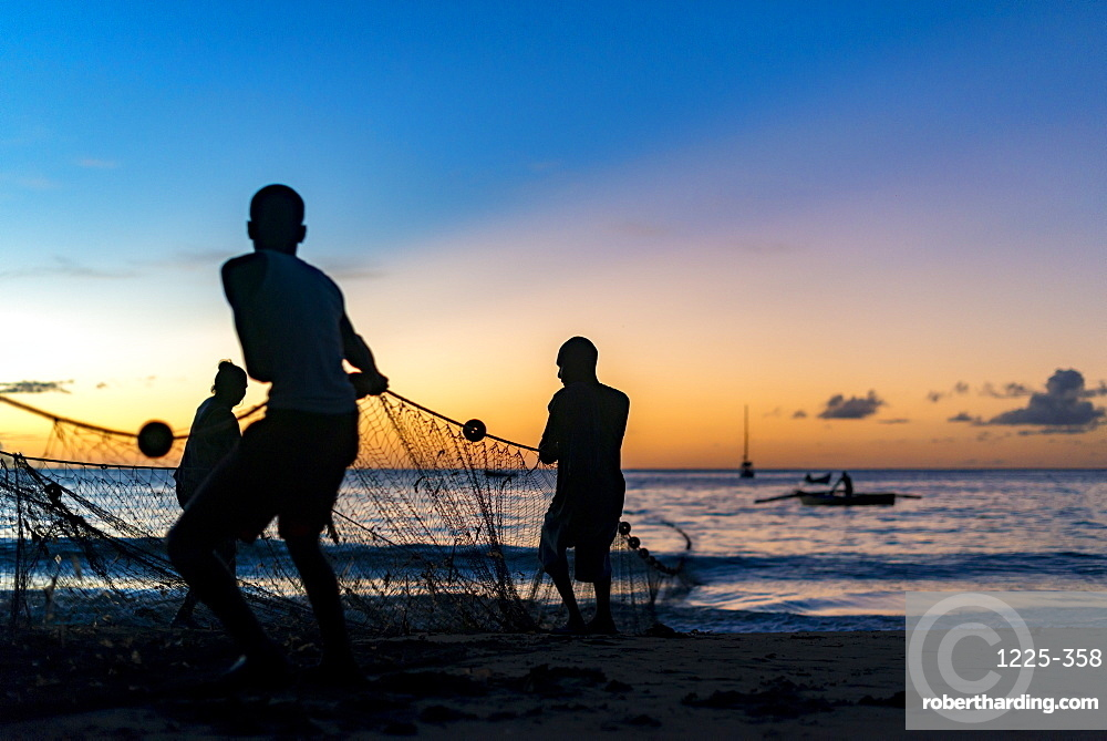 Seine net fishermen haul in a catch of fish in Castara Bay on the Caribbean island of Tobago, Trinidad and Tobago, West Indies, Caribbean, Central America