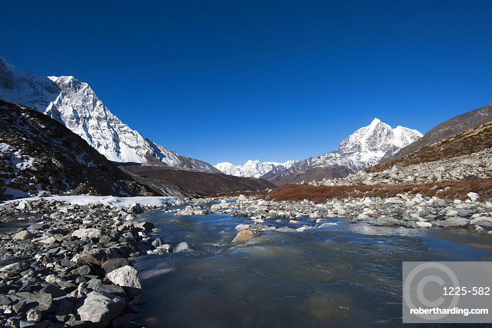 Icy meltwater flows down the Chekhung valley with views of Ama Dablam to the left and Taboche to the right, Khumbu Region, Nepal, Himalayas, Asia