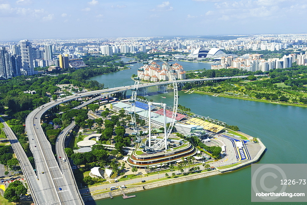 High view over Singapore with the Singapore Flyer ferris wheel and ECP expressway, Singapore, Southeast Asia, Asia