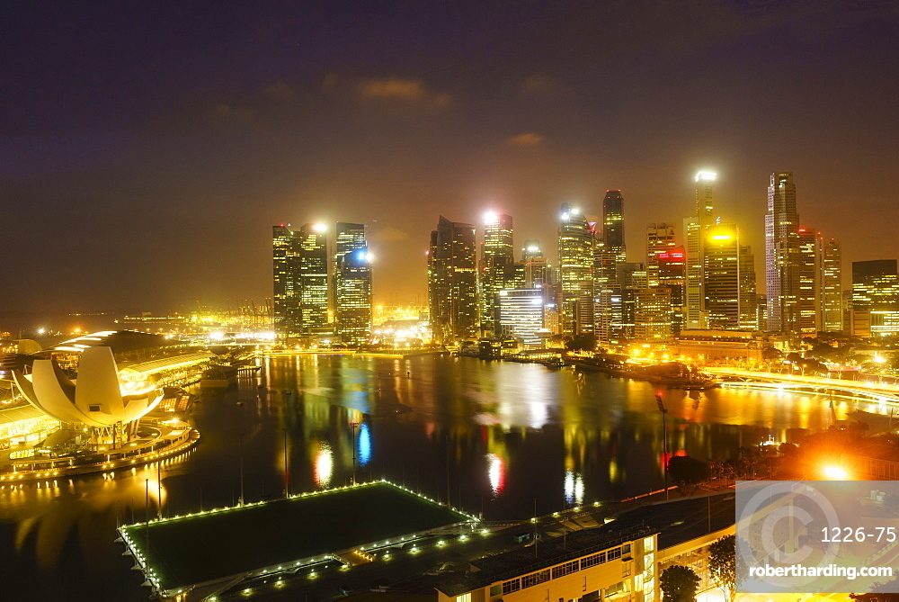 The towers of the Central Business District and Marina Bay by night, Singapore, Southeast Asia, Asia