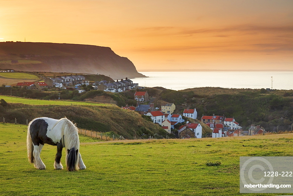 Staithes fishing village and distant Boulby Cliffs on the North Yorkshire Heritage Coastline.