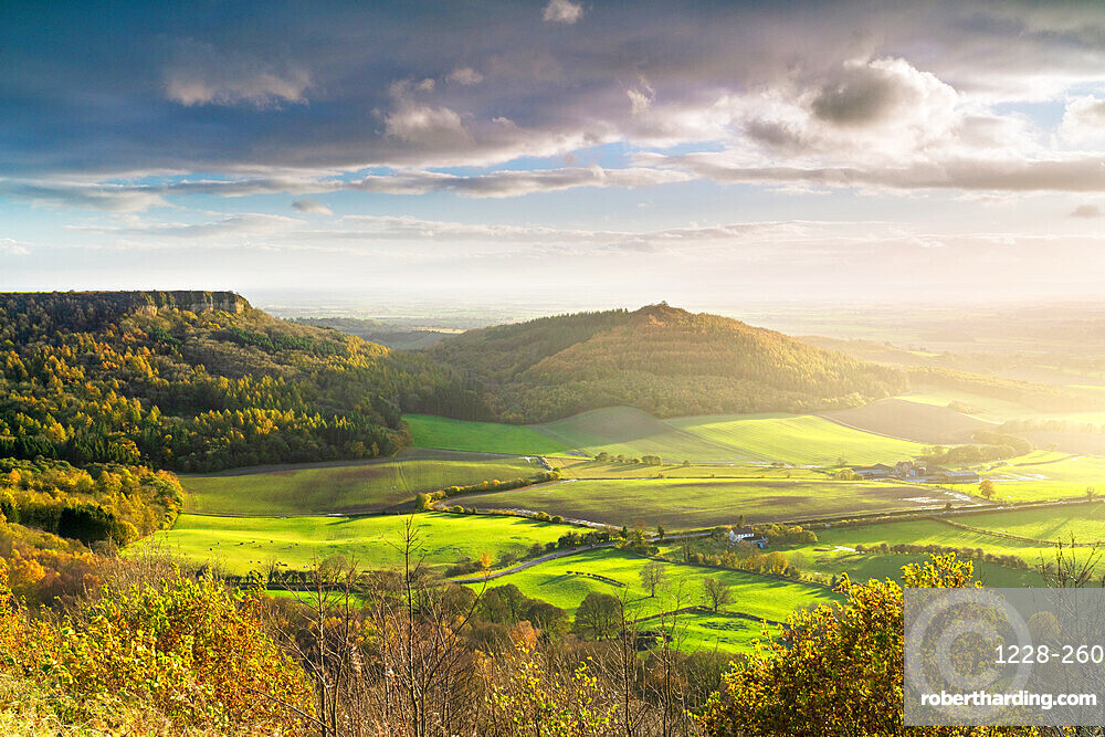 Dramatic weather and skies over The Vale of York from Sutton Bank, The North Yorkshire Moors, UK