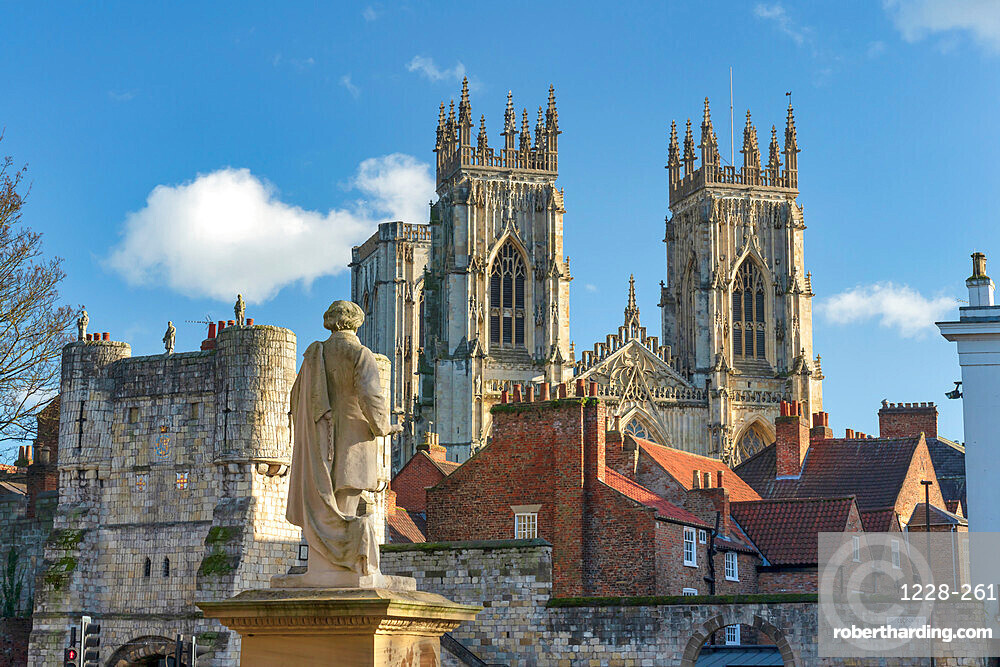 York Minster West bell Towers and bootham bar from St Leonards Place, York, north Yorkshire, England.