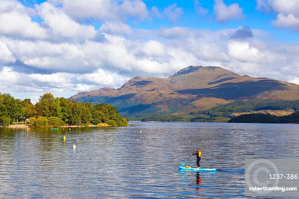 Paddle boarding, Luss, Loch Lomond, Ben Lomond, Scotland, United Kingdom, Europe