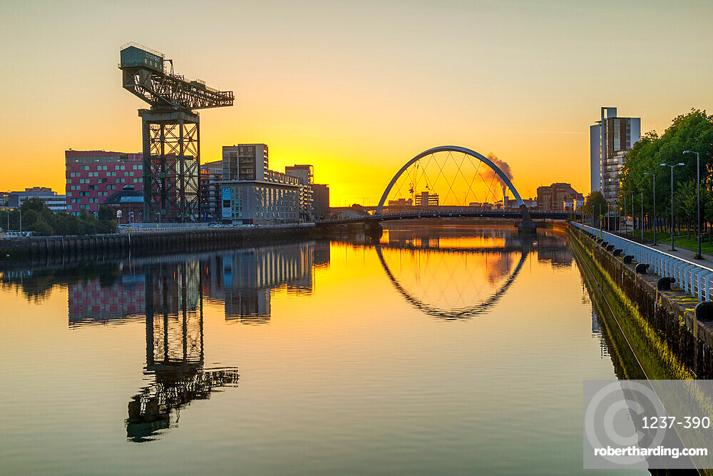 Sunrise over River Clyde, Finnieston Crane, Clyde Arc (Squinty) Bridge, Glasgow, Scotland, United Kingdom, Europe