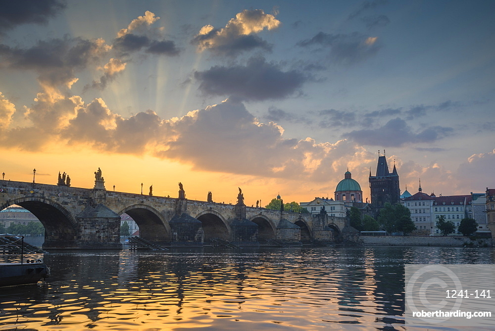 Colourful sunrise over the Charles Bridge with the Old Town Tower and Stare Mesto, UNESCO World Heritage Site, Prague, Czech Republic, Europe