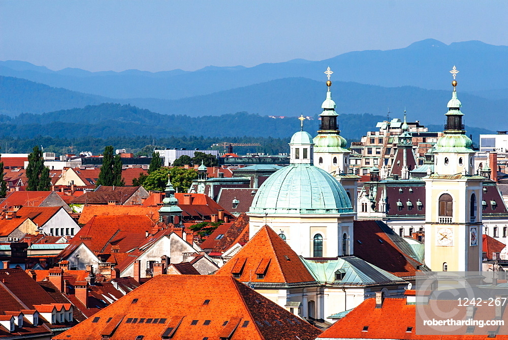 City rooftops with mountains, Ljubljana, Slovenia, Europe