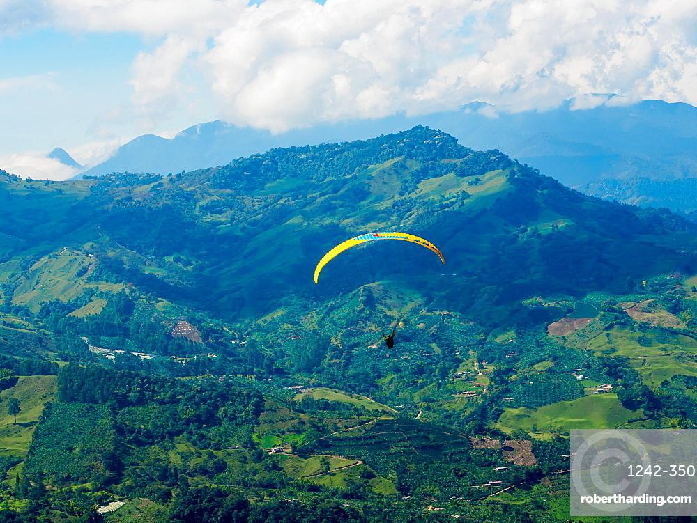 Paraglider soars near Jardin, Antioquia, Colombia, South America