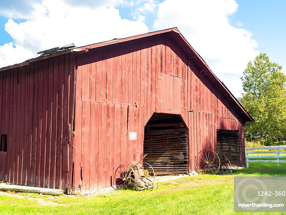 Red barn and old farm equipment, Valle Crucis, North Carolina, United States