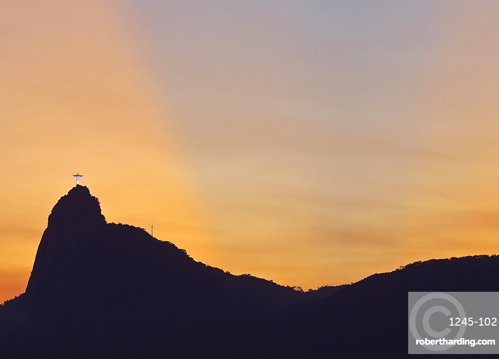 Sunset view of Christ the Redeemer statue and Corcovado Mountain, Rio de Janeiro, Brazil, South America