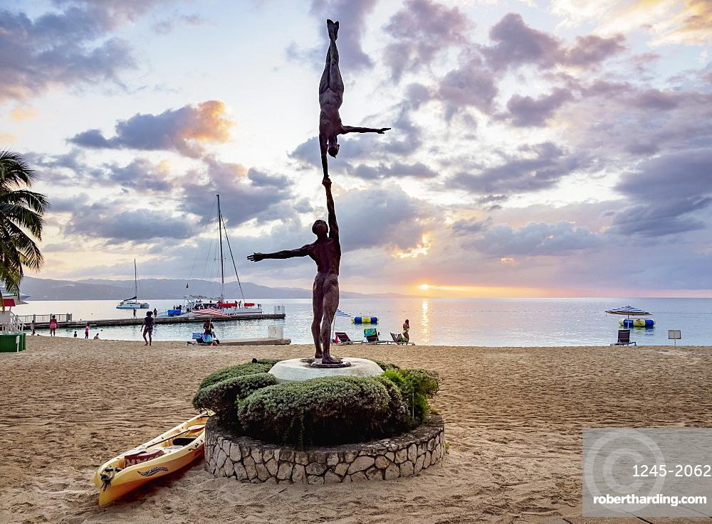 Statue Balance by Basil Watson at sunset, Doctor's Cave Beach, Montego Bay, Saint James Parish, Jamaica, West Indies, Caribbean, Central America
