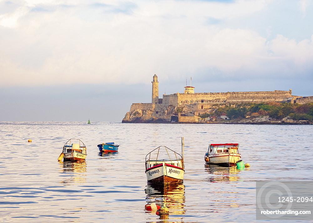 Fishing Boats and El Morro Castle at sunrise, Havana, La Habana Province, Cuba, West Indies, Central America