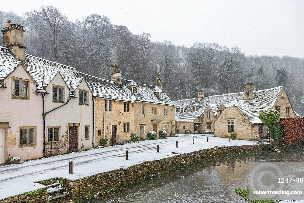 Snow covered houses by By Brook in Castle Combe, Wiltshire, England, United Kingdom, Europe