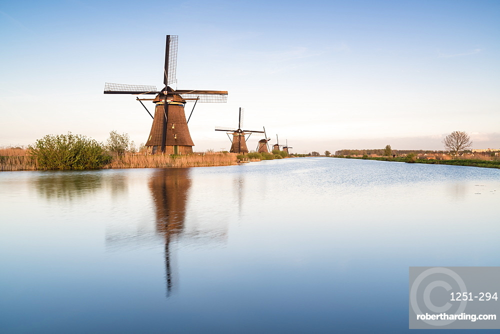 Windmills in a row on the canal, Kinderdijk, UNESCO World Heritage Site, Molenwaard municipality, South Holland province, Netherlands, Europe
