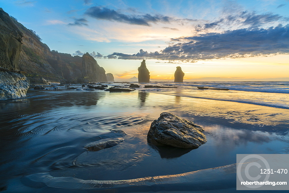 Reflection of the Three Sisters with low tide, at sunset, Tongaporutu, New Plymouth district, Taranaki region, North Island, New Zealand, Pacific