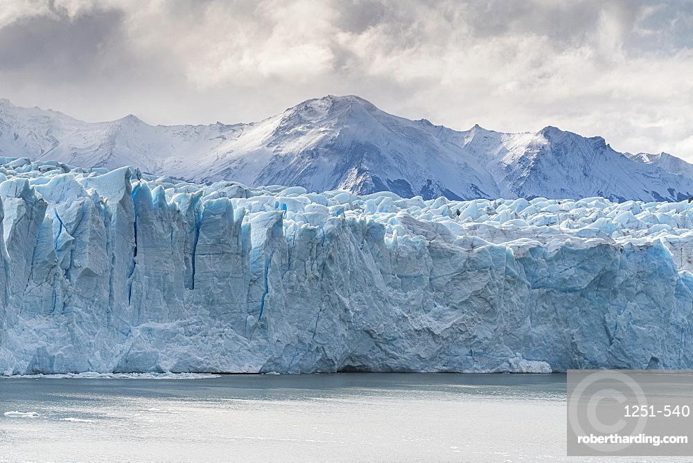 Perito Moreno glacier and mountain peak under a moody sky, Los Glaciares National Park, UNESCO World Heritage Site, Santa Cruz, Argentina, South America