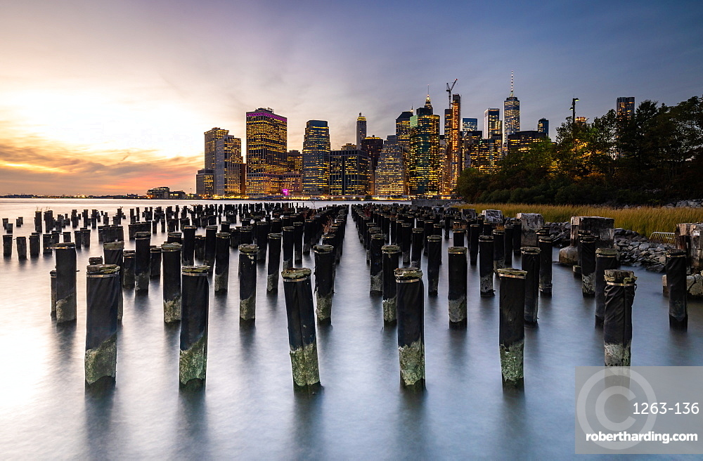 Long exposure of the lights of Lower Manhattan during sunset as seen from Brooklyn Bridge Park, New York, United States of America, North America