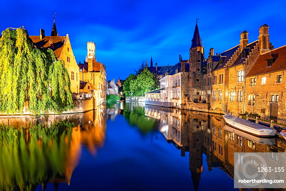 The beautiful buildings of Bruges reflected in the still waters of the canal.