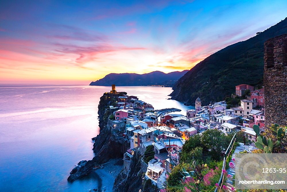 The remains of a stunning sunset over the old town and harbour of Vernazza, Cinque Terre, UNESCO World Heritage Site, Liguria, Italy, Europe
