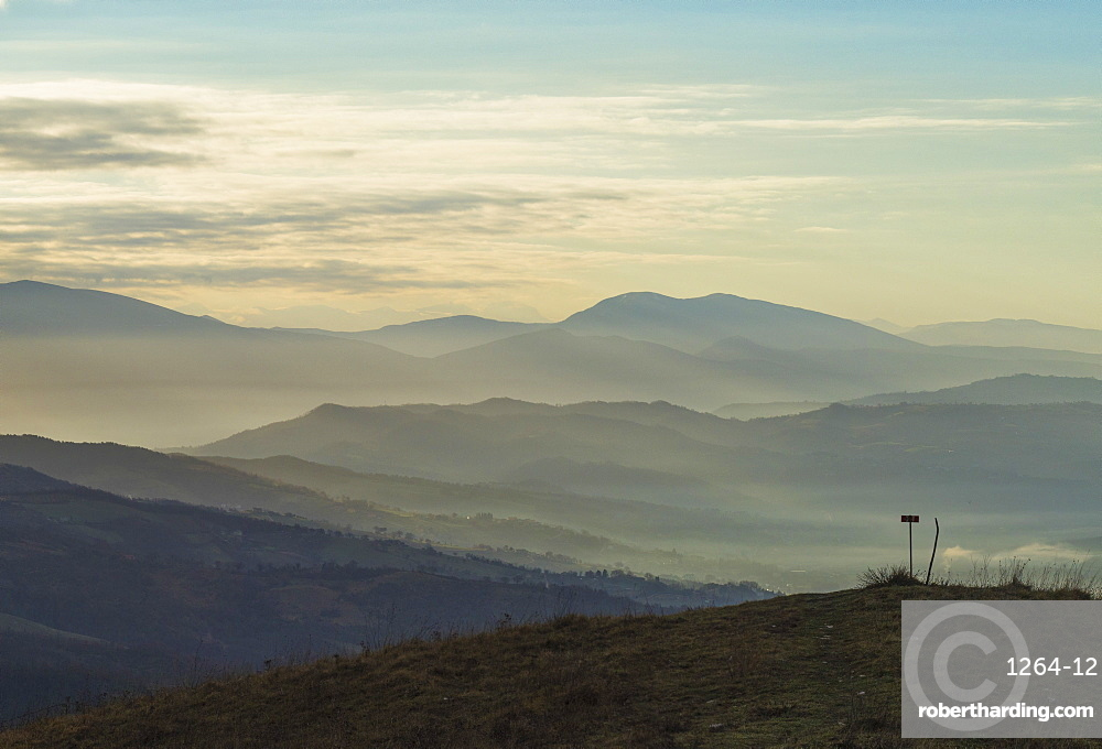 Sunrise on Apennines on a winter day with fog, Gubbio, Umbria, Italy, Europe