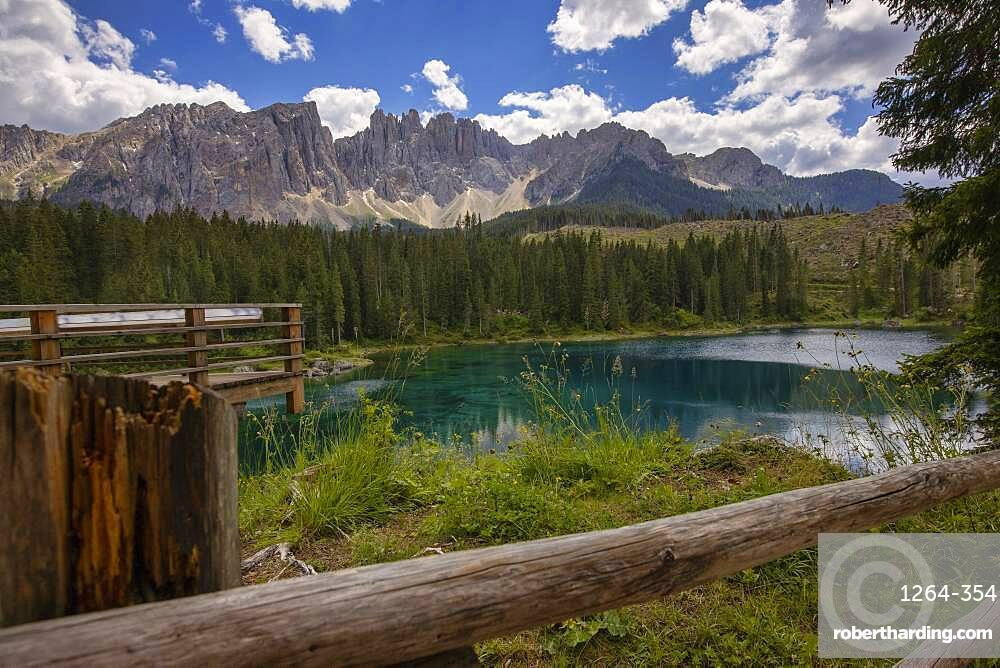 Italy, Dolomites, South Tyrol, Karersee, Latemar mountain range reflected in lake Carezza in Summer