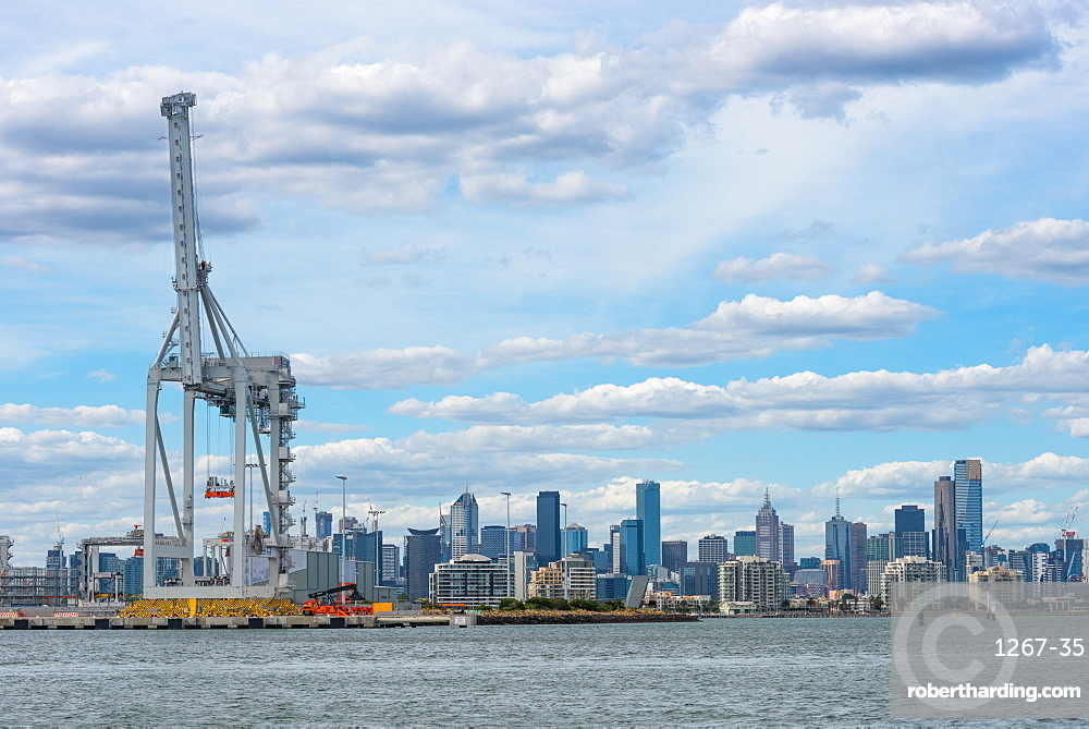 Container quayside crane in the Port of Melbourne with city skyline, Melbourne, Victoria, Australia, Pacific