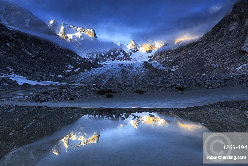 Forno Glacier reflected in a pond at foggy sunrise, Forno Valley, Maloja Pass, Engadine, Graubunden, Switzerland, Europe