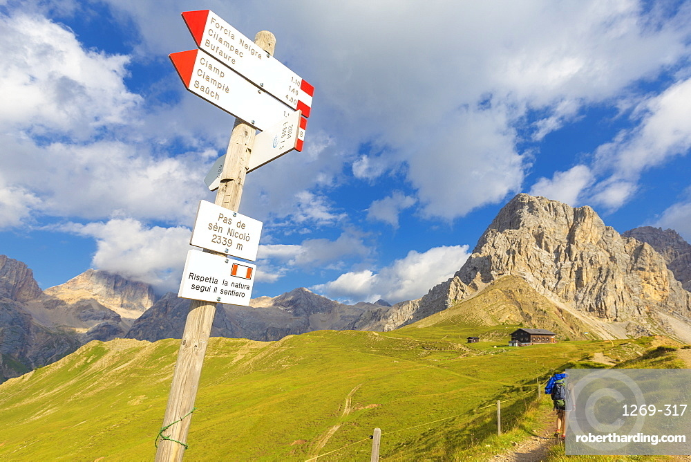 Hiking signs at San Nicolo Pass, Fassa Valley, Trentino, Dolomites, Italy, Europe