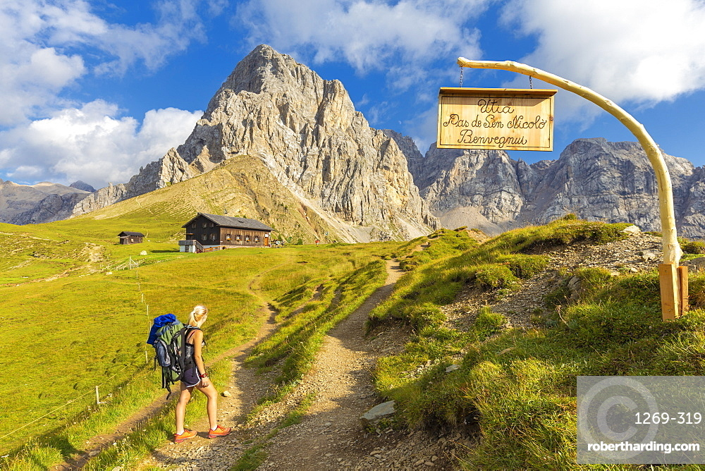 Hiker at Passo San Nicolo Refuge, San Nicolo Pass, Fassa Valley, Trentino, Dolomites, Italy, Europe
