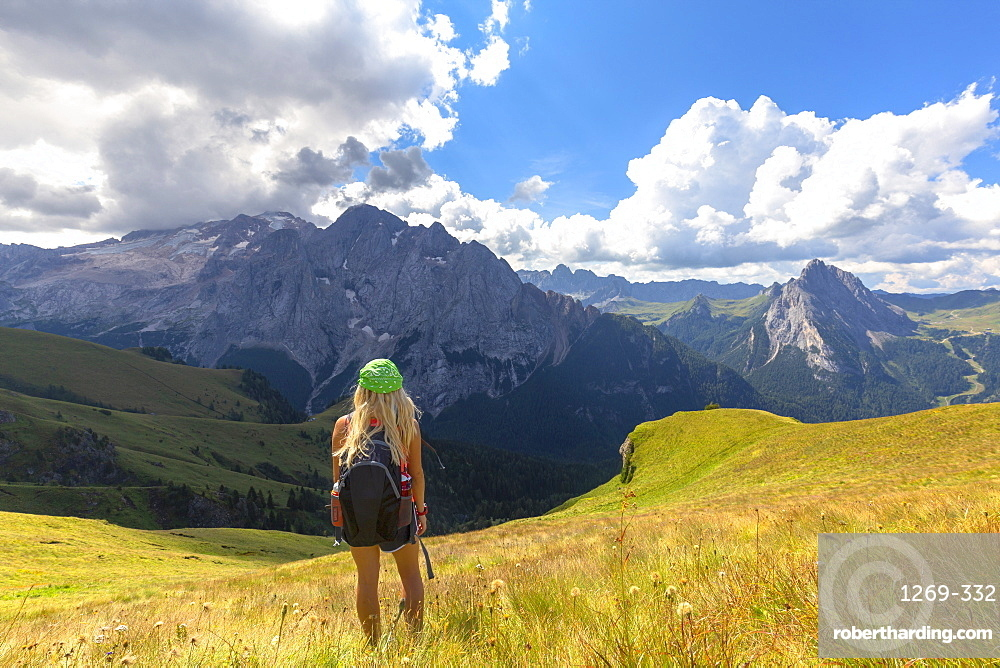 Girl looks towards Marmolada from Viel del Pan path, Pordoi Pass, Fassa Valley, Trentino, Dolomites, Italy, Europe