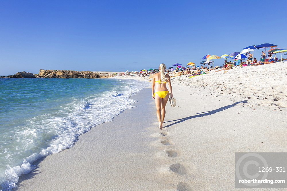 Young girl in a yellow swimsuit walks on the beach of Is Arutas, Cabras, Oristano province, Sardinia, Italy, Mediterranean, Europe