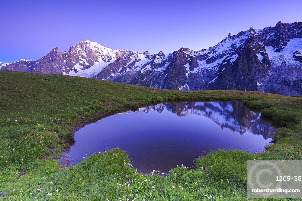 Twilight illuminates Mont Blanc, Mont de la Saxe, Ferret Valley, Courmayeur, Aosta Valley, Italy, Europe