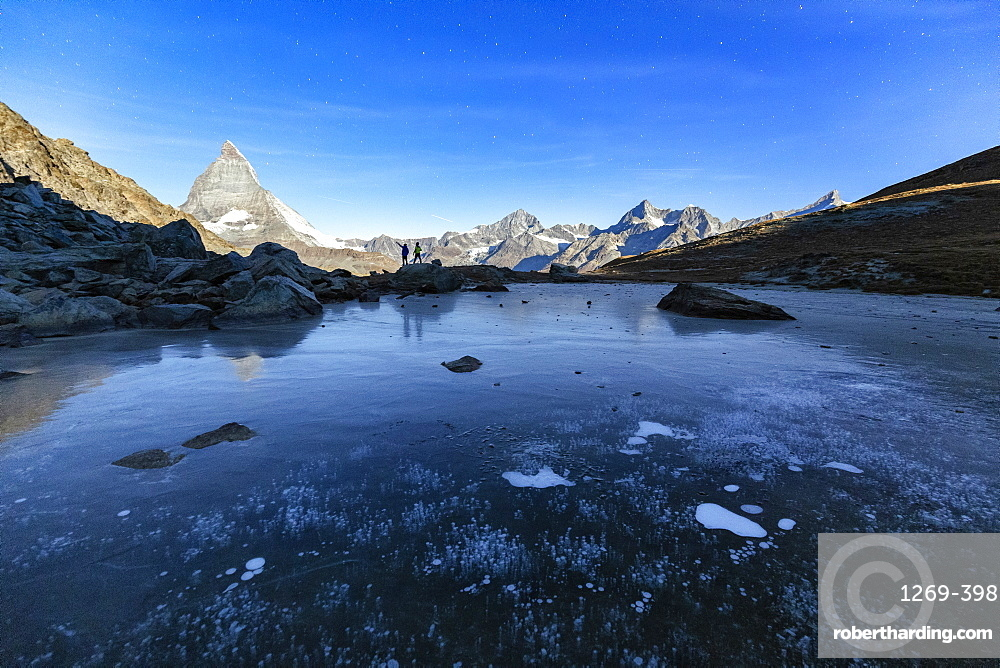 Frozen Riffelsee lake by Matterhorn in Switzerland, Europe