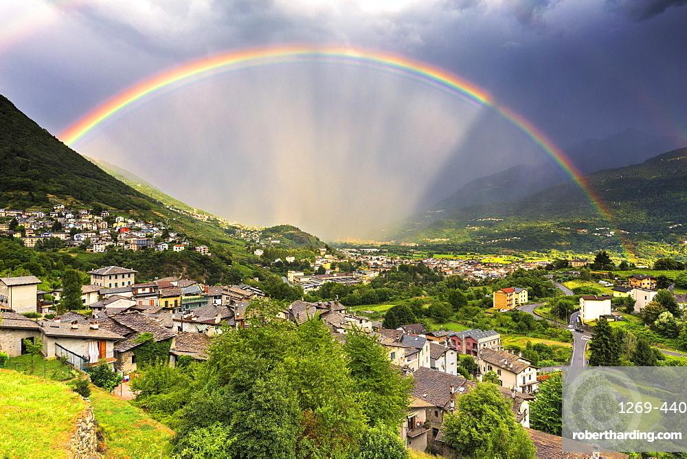 Rainbow above the valley, Valtellina, Lombardy, Italy, Europe