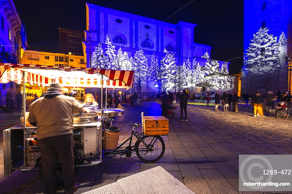 Chestnut seller in the square at night, Sondrio, Valtellina, Sondrio province, Lombardy, Italy, Europe