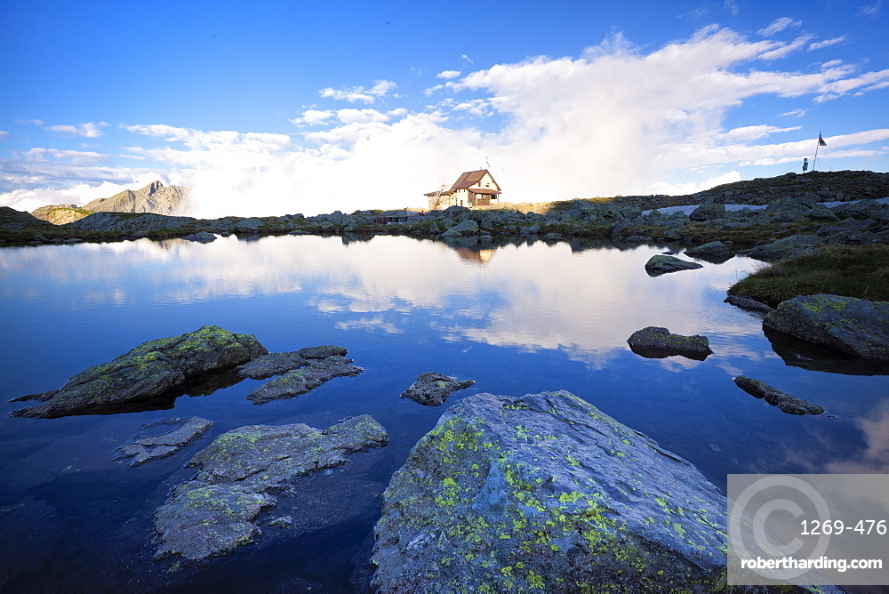 Benigni Refuge reflected with fog in the lake, Val Brembana, Lombardy, Italy, Europe