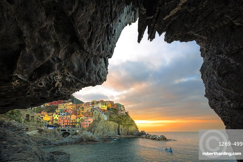 Sunrise on the village of Manarola from a sea cave, Cinque Terre, UNESCO World Heritage Site, Liguria, Italy, Europe
