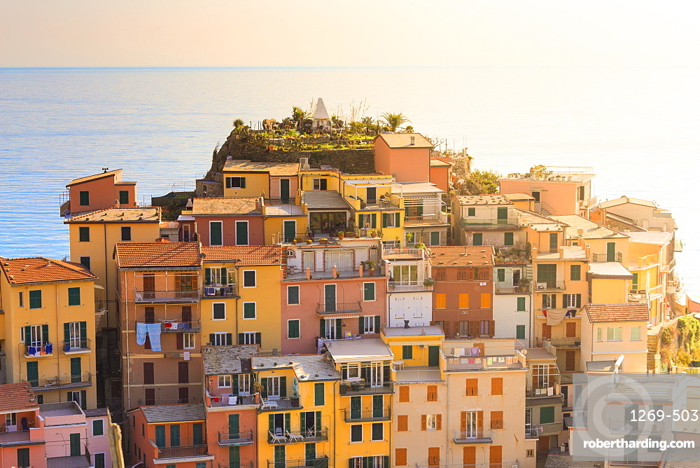 Sunlight behind the houses of Manarola, Cinque Terre, UNESCO World Heritage Site, Liguria, Italy, Europe
